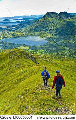 Stock Photo of Two hikers descending Pyramid Mountain summit on.