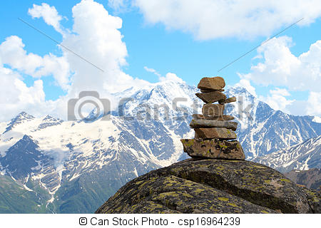 Stock Photos of pyramid of stones and mountains with blue cloudy.