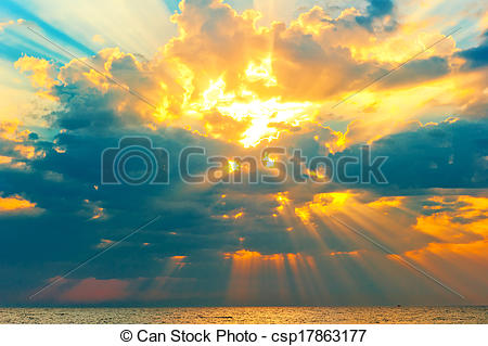 Picture of golden rays of the sun breaking through the storm.