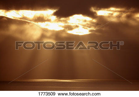 Stock Photograph of Sun breaking through clouds 1773509.