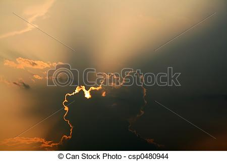 Stock Photo of Sun Breaking Through Clouds in the Sky csp0480944.