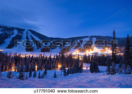 Stock Photography of The Village at Sun Peaks Ski Resort glows in.