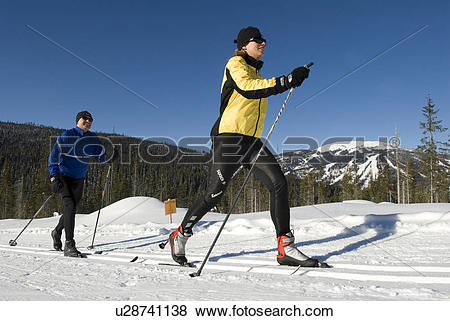 Pictures of Professional couple cross country skiing, Sun Peaks.