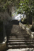 Stock Photo of Sun dappled outside steps in Lisbon, Portugal.