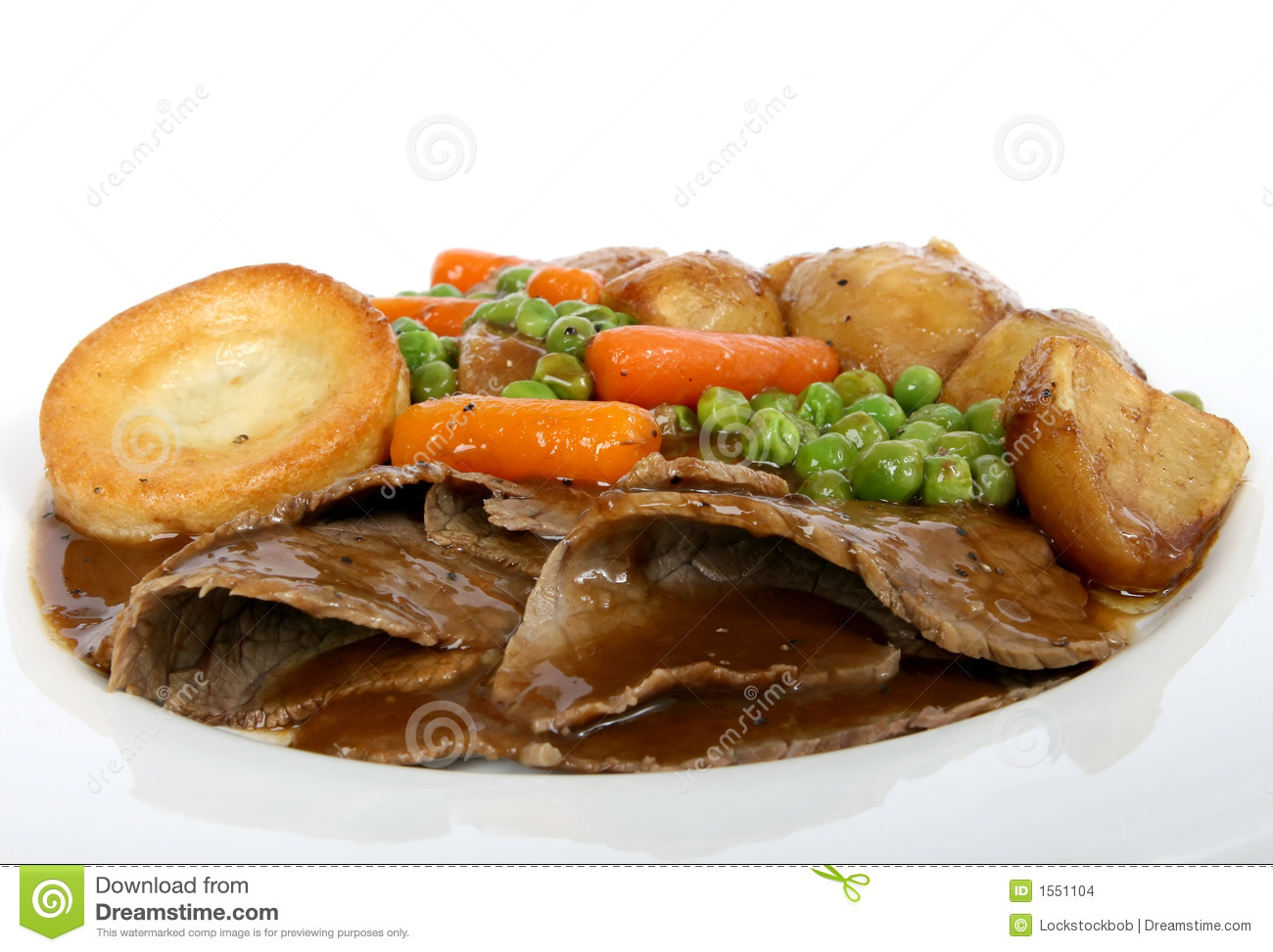Traditional English Food Sunday Roast Lunch In Restaurant Stock.