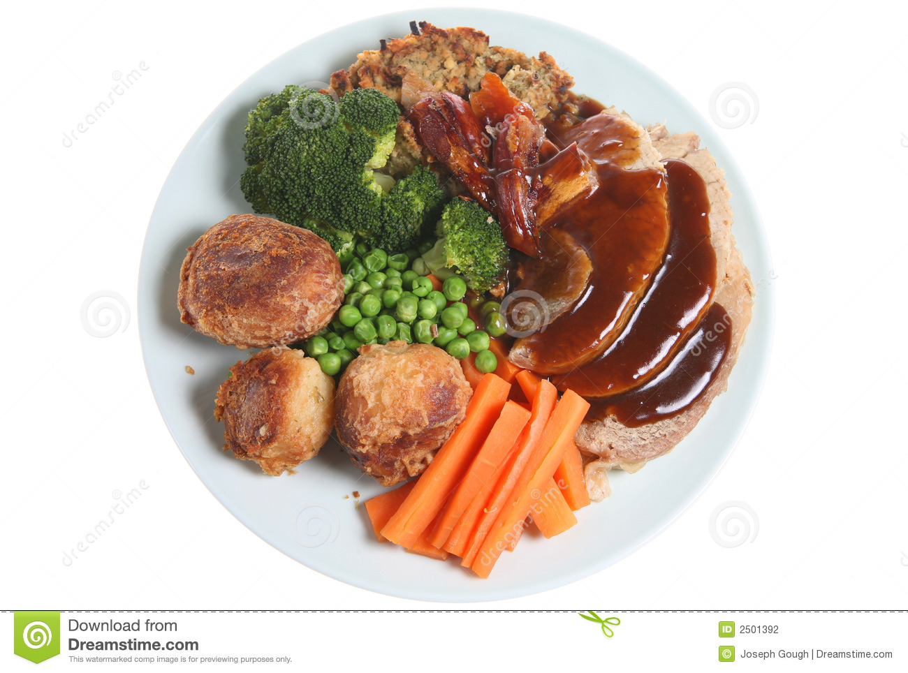 Sunday Roast Pork Dinner From Above Stock Photo.