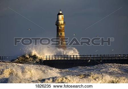 Stock Image of Lighthouse and waves, Sunderland, Tyne and Wear.