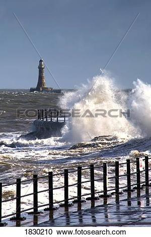 Stock Photography of Waves crashing by lighthouse at Sunderland.