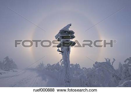Pictures of View of sundog with directional sign in snowy.