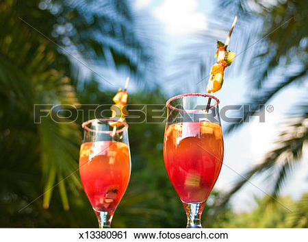 Stock Photography of Sundowner cocktails with palm trees in.