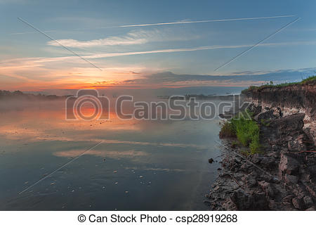 Stock Image of Reflection of the first rays of dawn sunlight in.
