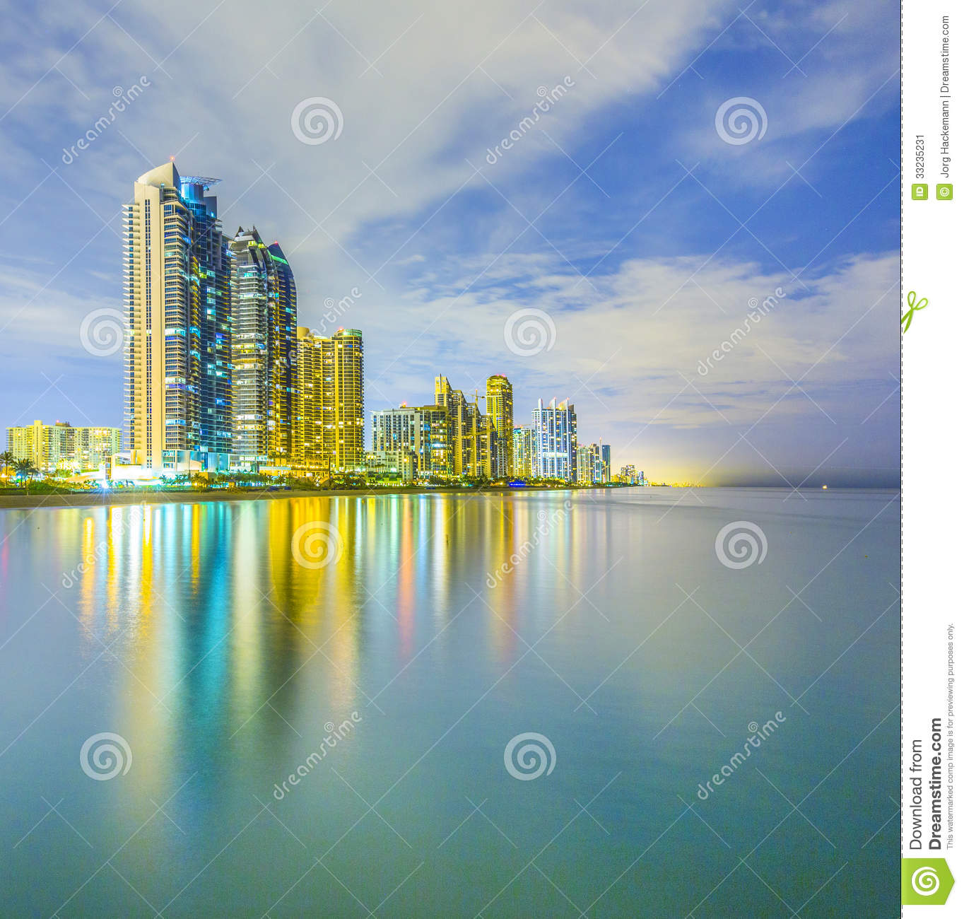 Skyline Of Sunny Isles Beach By Night With Reflections At The.