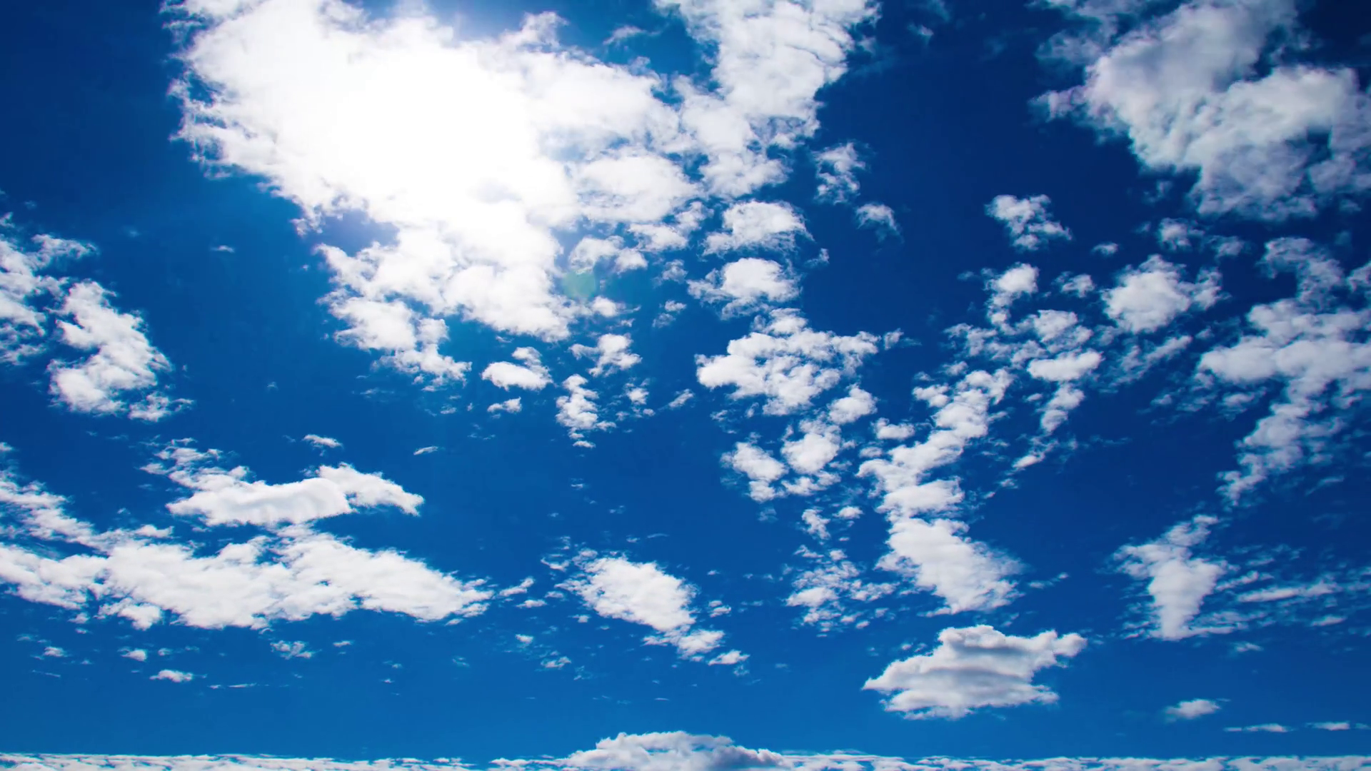 Running clouds on the sunny sky. Timelapse Stock Video Footage.