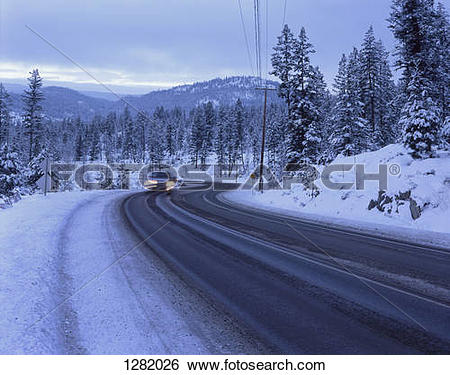 Stock Images of Car on snowy mountain road at Sunpeaks resort in.