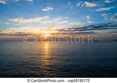 beautiful sunrise over sea from drone view.