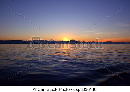 Beautiful sunset sunrise over blue sea ocean red sky.