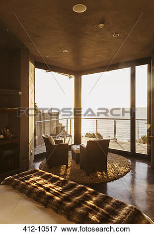 Picture of Luxury bedroom overlooking ocean at sunset 412.