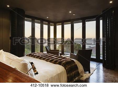 Pictures of Luxury bedroom overlooking ocean at sunset 412.