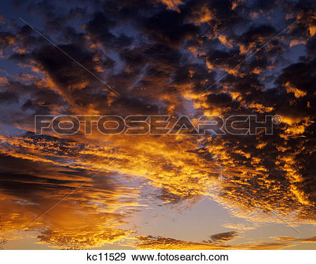 Stock Photograph of Clouds With Sunrise Sunset Glow kc11529.