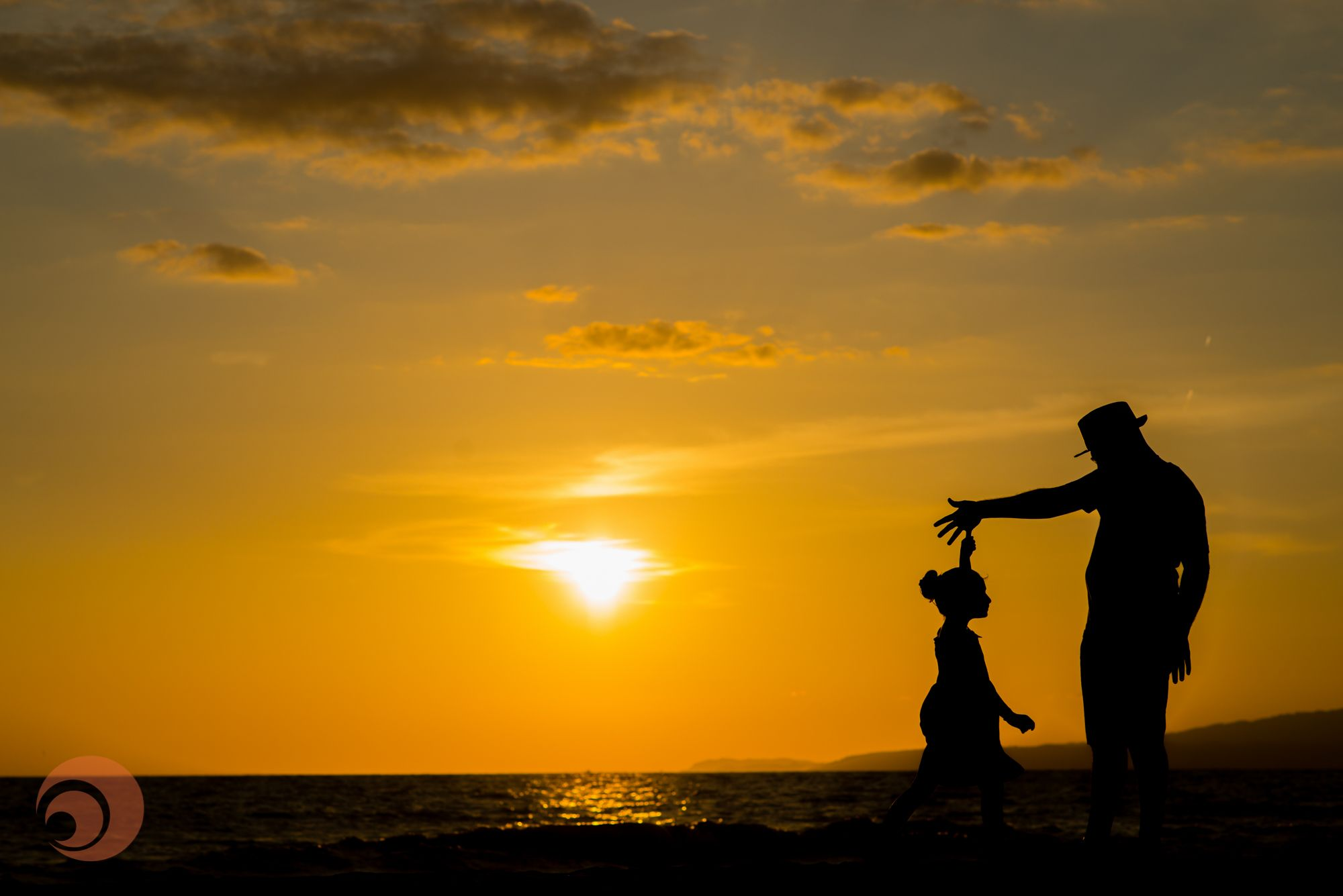 Father and daughter silhouettes dancing in this beautiful.