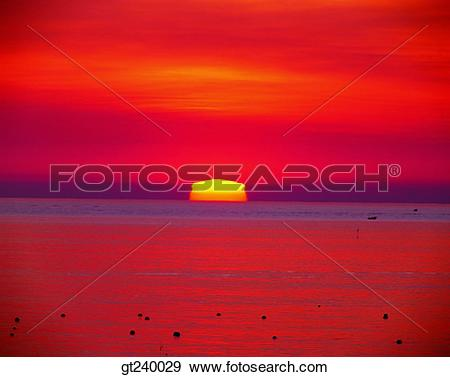 Stock Photograph of exterior, outdoor, sunset, night, red sky.