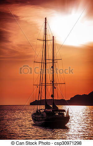 Stock Photographs of Old ship sailing to the sunset. Dramatic sea.