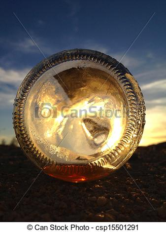 Stock Photographs of Sunset through a bottle..