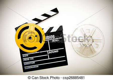 Pictures of Movie clapper board and super 8 mm reels vintage color.