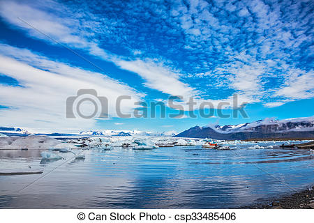 Stock Photography of Stratus clouds are reflected in the surface.