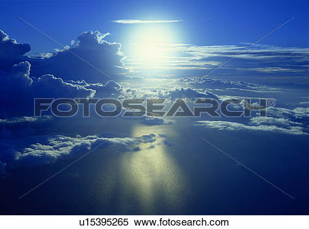Stock Image of Clouds over calm ocean surface u15395265.