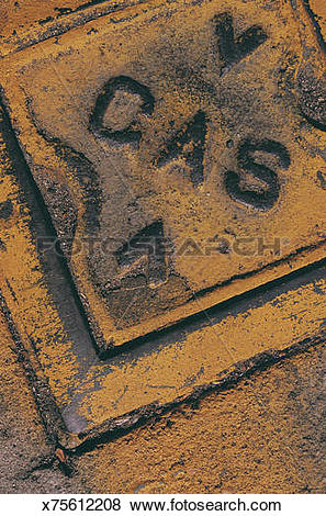 Pictures of Lettering embossed on metal surface sprayed with.