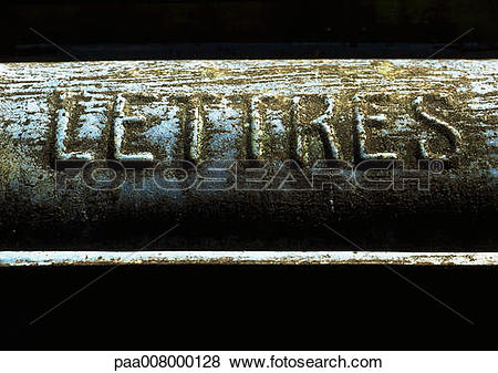 Pictures of Letters typography embossed in French on dirty surface.