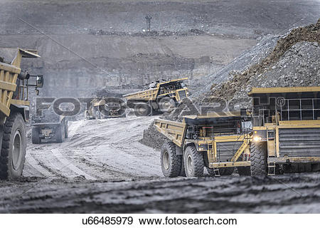 Stock Photograph of Dumper trucks in surface coal mine u66485979.