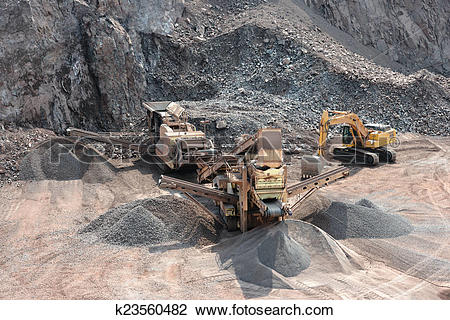 Stock Photo of stone crusher in surface mine k23560482.