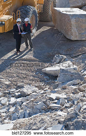Stock Image of manager and worker in marble quarry bld127295.