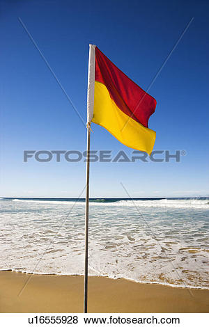 Pictures of Red and yellow flag on beach in Surfers Paradise.