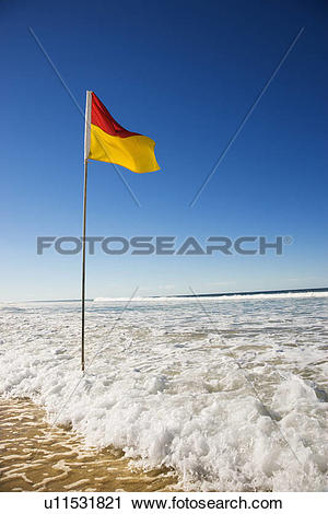 Stock Photography of Red and yellow flag on beach in Surfers.