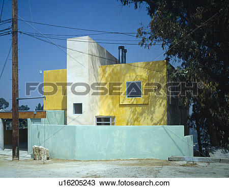 Stock Photo of Modern yellow house with pale turquoise surrounding.
