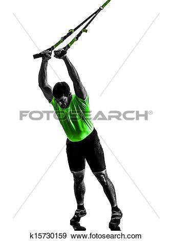 Stock Photograph of man exercising suspension training trx.