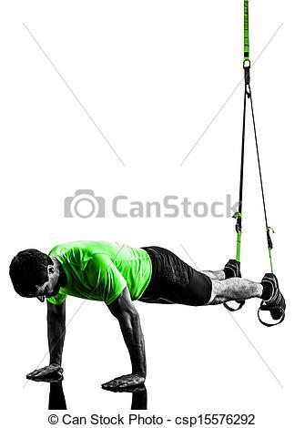 Stock Photographs of man exercising suspension training trx.