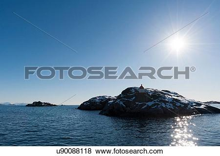 Pictures of Sunlit rocky island, Svolvaer, Lofoten Islands, Norway.
