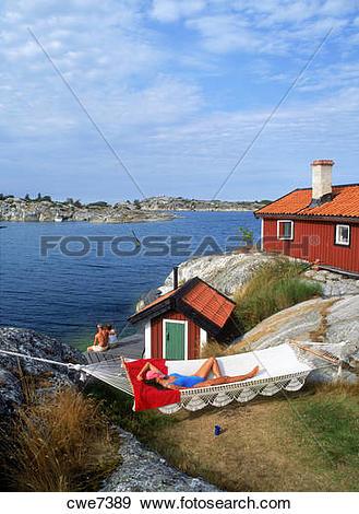 Stock Photograph of Woman resting in hammock on Huvudskar.