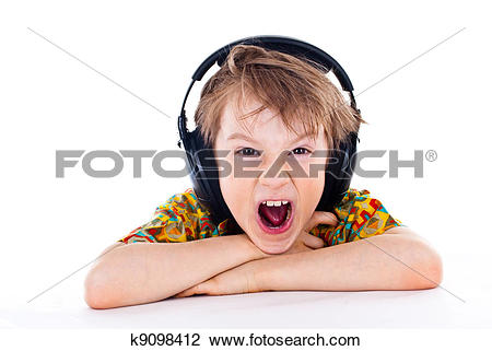 Stock Photo of Portrait of a sweet young boy listening to music on.