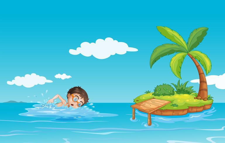 A boy swimming at the beach.