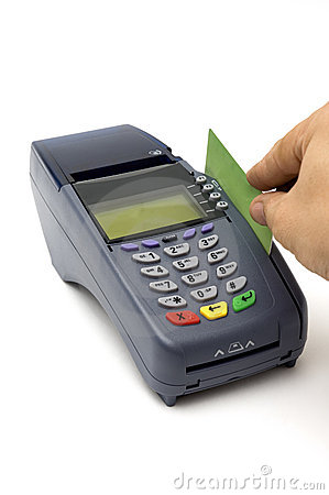 POS Terminal Transaction. Hand Swiping A Credit Card. Stock Photo.