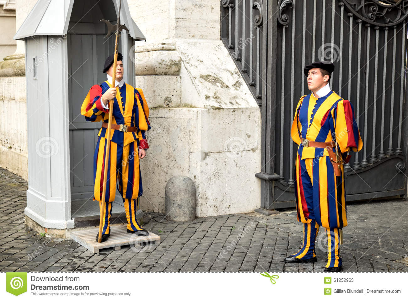 Two Swiss Guards In Traditional Uniform On Duty At A Vatican Gate.