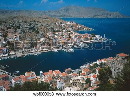 Stock Photo of Greece, Symi, View of city with mountains in.