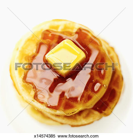 Stock Image of high angle view of waffles served with syrup and.