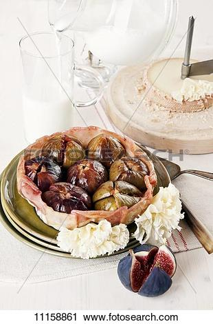 Stock Photography of Fig tarte tatin with Tête de Moine cheese.