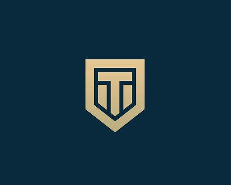 Abstract letter T shield logo design template. Premium.